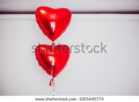 red heart balloons on a white background, valentines day