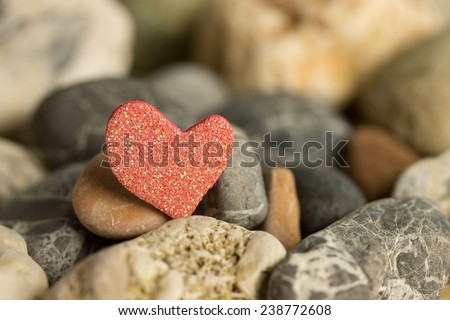 red heart between stones - stock photo