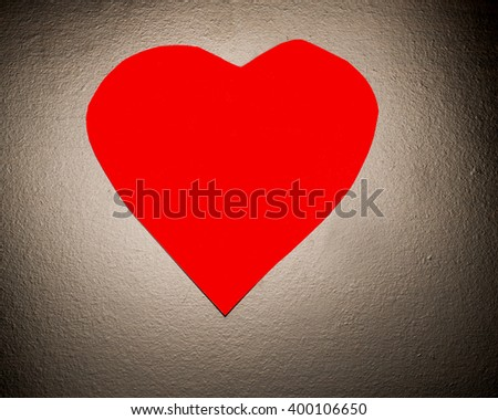 Red Heart for a dark surface/Red Heart/Heart symbolizing romance or health - stock photo