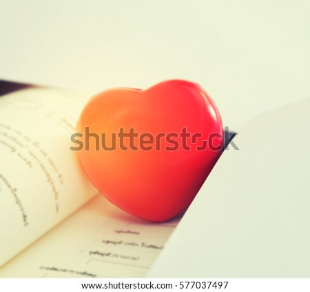 Red heart for love concept for valentines day with sweet and romantic moment on the book.