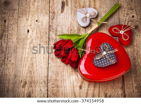 Red heart gift valentines day on wooden board - stock photo