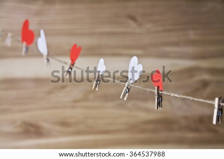 red heart hanging on the clothespin - stock photo