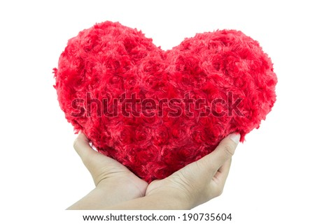 Red heart hold on hand isolated on white background - stock photo