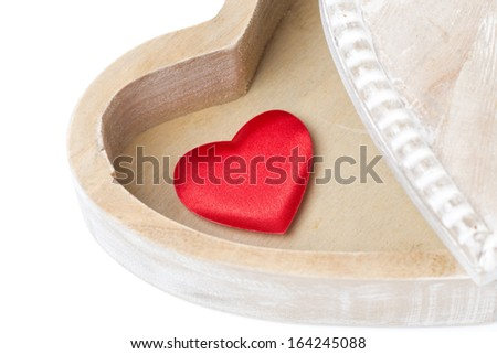 red heart in a wooden box, isolated on white
