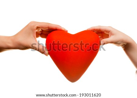 Red heart in hands, on  background