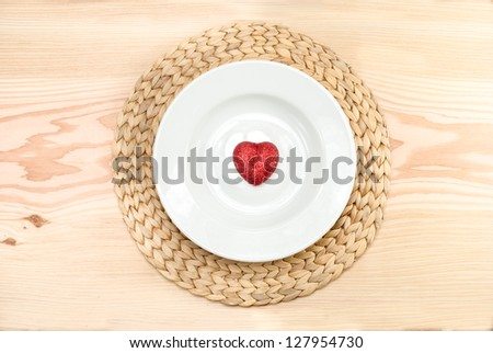 Red heart in plate