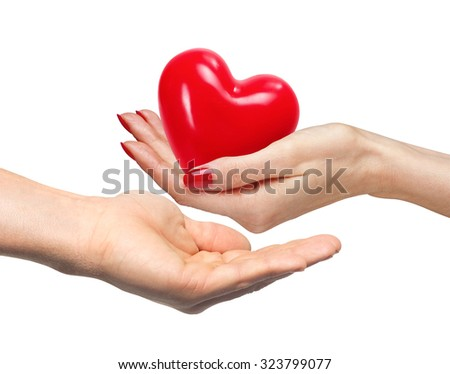 Red heart in woman hand and man hand, isolated on white