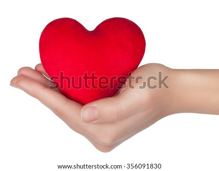 Red heart in woman hand isolated on white background - stock photo