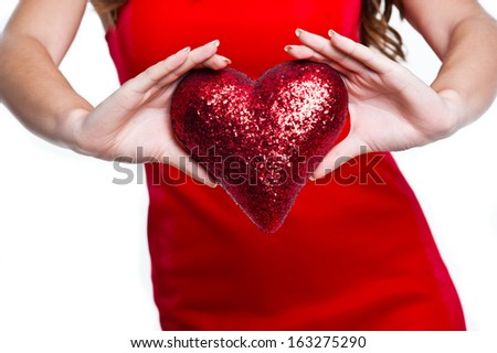 Red heart in woman hand. Valentine's day - stock photo