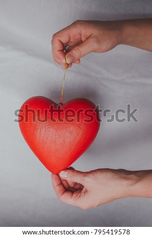 red heart in woman's hand isolated on white background