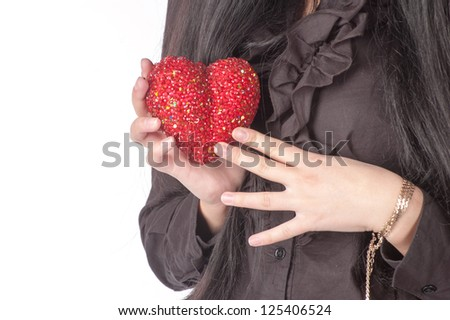 red heart in womens hands closeup over white background.