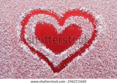Red heart inside the heart grated in the snow - stock photo