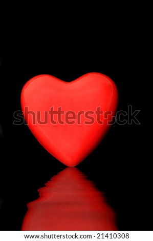 Red heart isolated on a dark back ground - stock photo