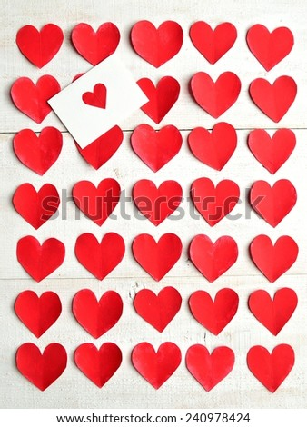 Red heart message card on red heart paper cut out background.Image of valentines day - stock photo