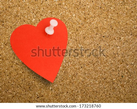 Red heart note on cork bulletin board - Valentine or other reminder. - stock photo
