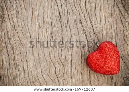 Red Heart of Valentines Day with grunge wood background.