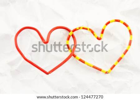 red heart on a background white crumpled office paper