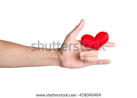 Red heart on a hand to show that you love someone. Red heart on an ILY sign hand isolated on white background. Valentine's day theme. - stock photo