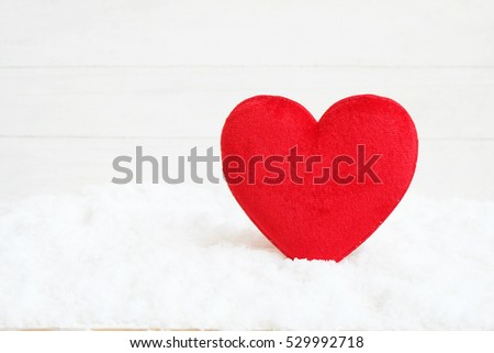 Red heart on a snow