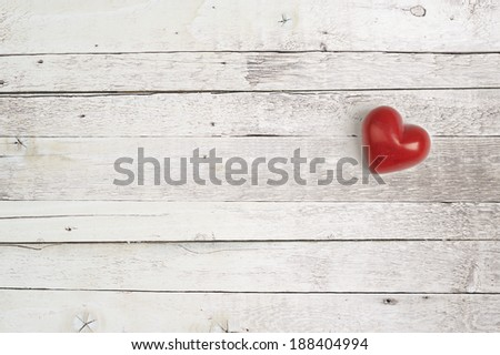 red heart on a wooden background for lovers and valentine day - stock photo