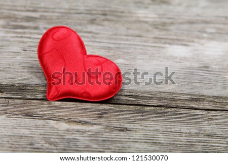 Red heart on a wooden background. Valentines Day.