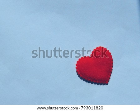 Red heart on blue paper background. Concept for Valentine day and love.copy space