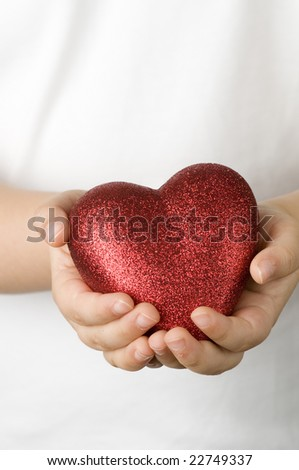 Red heart on child  hands