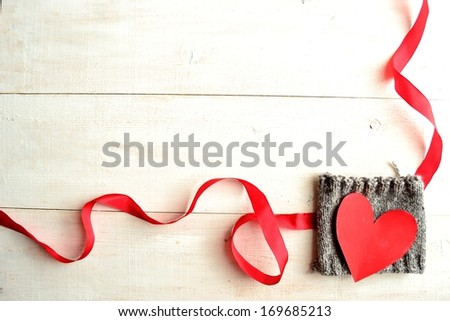 Red heart on knit with red ribbon.Image of Valentines day.