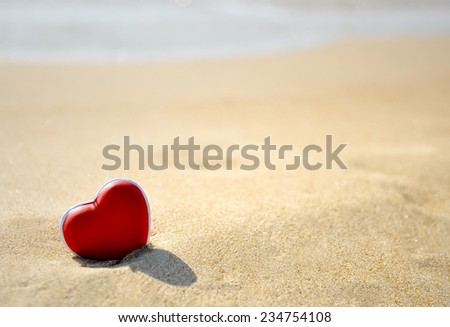 red heart on sandy sea beach - love Valentine's Day concept - stock photo