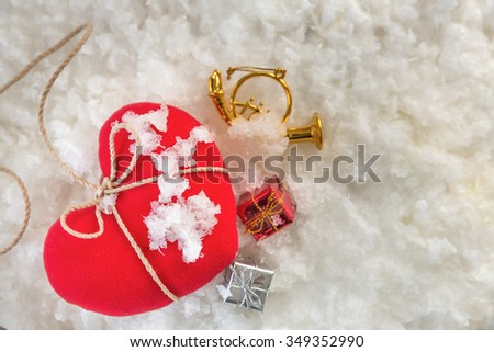 red heart on snow background-Valentine concept