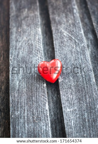 Red heart on the shabby wooden board, Valentine`s concept - stock photo