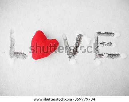 Red heart on the snow. Valentine's day concept. Love concept   - stock photo