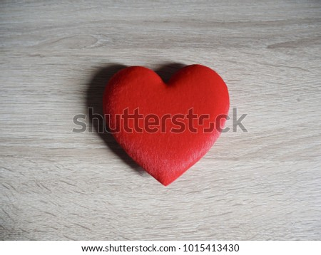 Red Heart on the wood table
