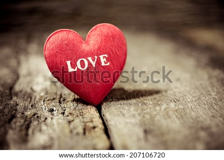 Red heart on wood board for valentine concept - stock photo