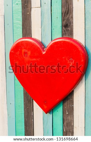 Red Heart on wood texture for background