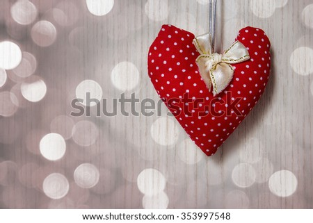 Red heart on wooden background with bokeh - stock photo