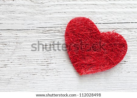 red heart on wooden background with copy space