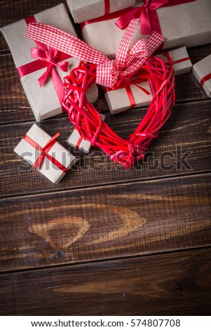Red heart on wooden boards
