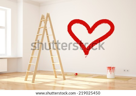 Red heart painted on wall as symbol for love - stock photo