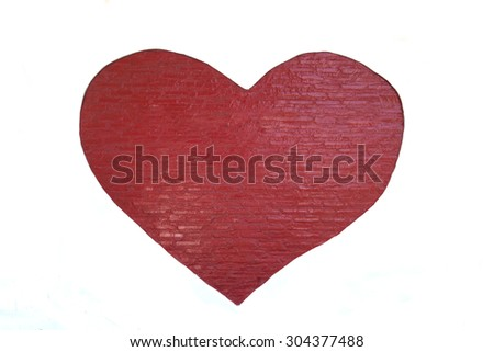 red heart painting on white cement wall