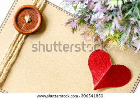 red heart paper and blank brown tag with leaf on white background. - stock photo