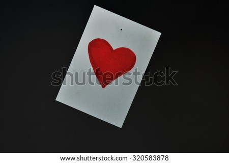red heart paper note on computer screen