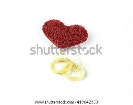 Red Heart Pillow of love and condoms aids safe on white background - stock photo