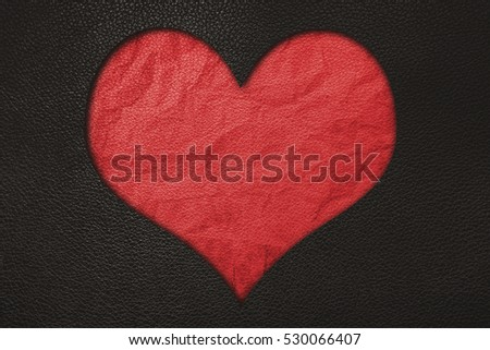 Red heart, red crumpled leather and black leather texture background