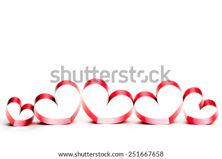Red heart ribbon, on white background. studio shot - stock photo