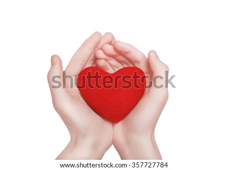 Red heart shape in hands. Valentine's day, charity and love concept