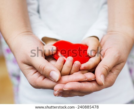Red Heart Shape In Mother And Child Hands.
