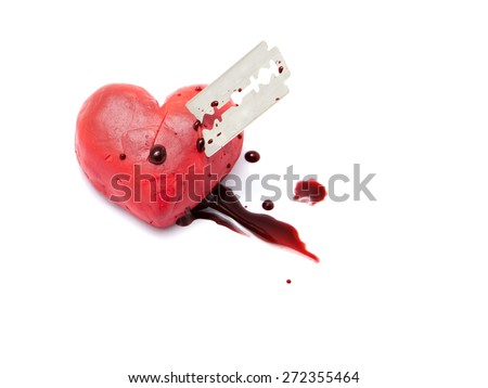 Red heart shape made by play dough stab by razor isolated on white background. concept of broken relationship. - stock photo