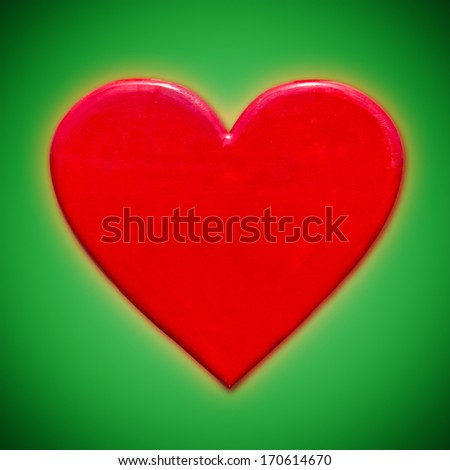 Red heart shape on green background