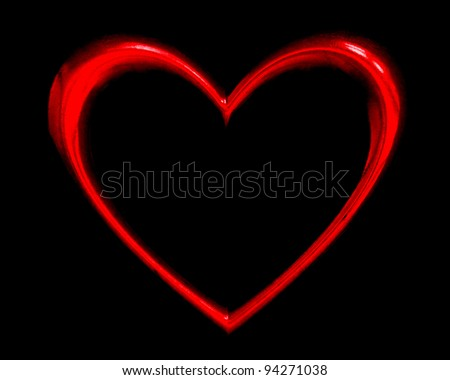 red heart shape over black background